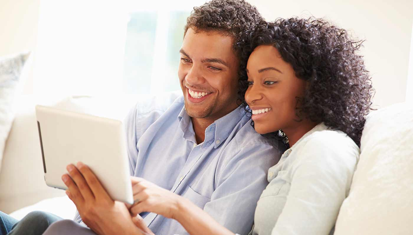 Happy couple looking at insurance benefits.