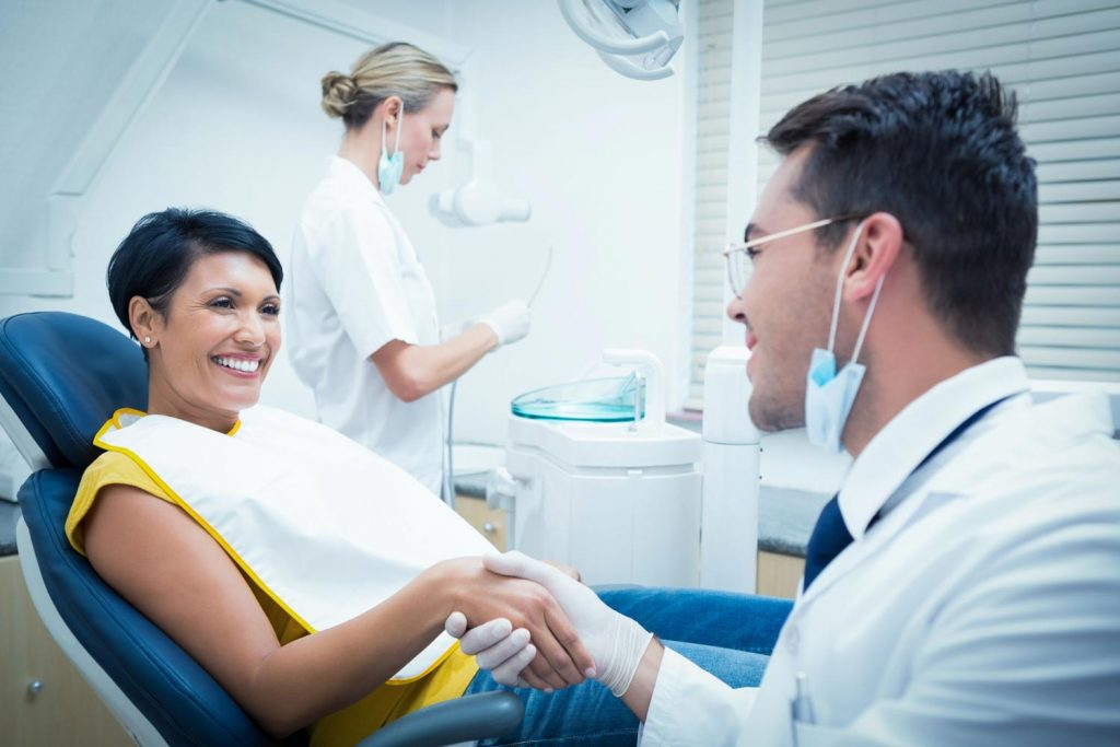 female patient smiling during a dental checkup