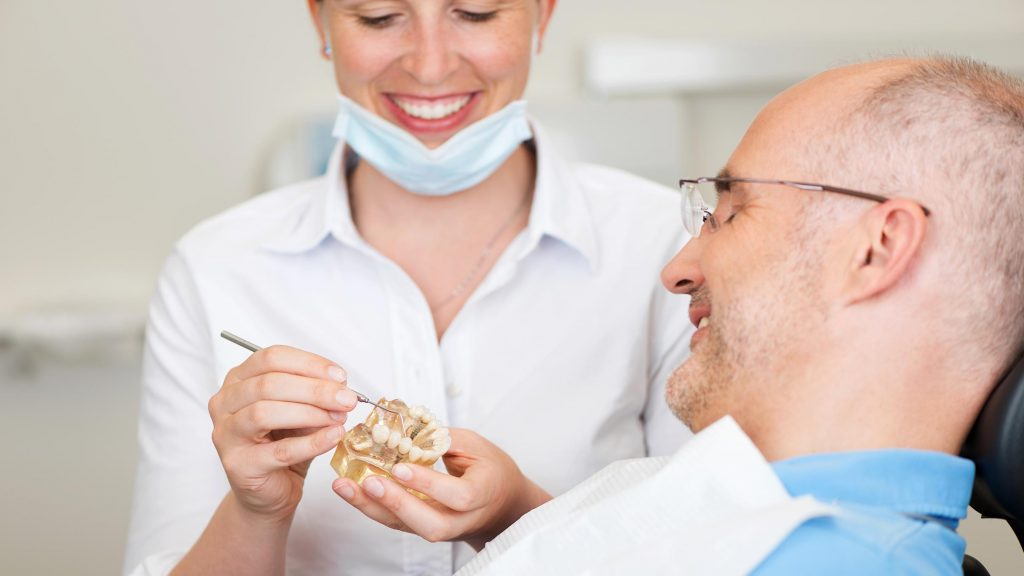 male patient getting a dental crown