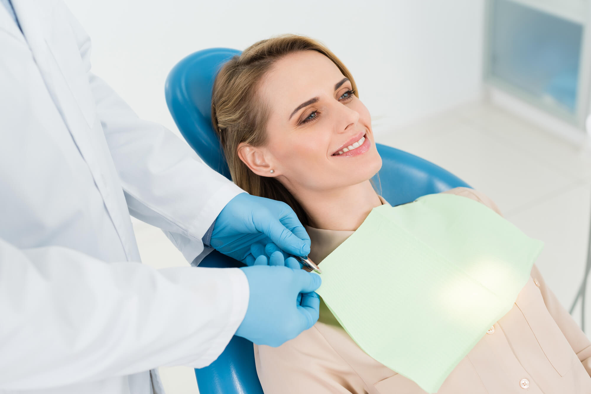 female patient smiling during her dental checkup