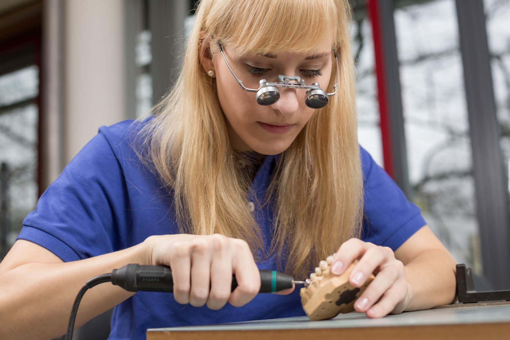 female dentist working on prosthetics
